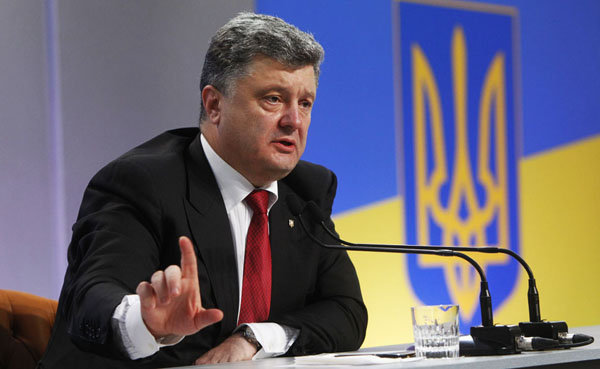 Ukraine's President Petro Poroshenko speaks to the media during a news conference in Kiev September 25, 2014. Ukraine and the rest of the world will not recognize local elections planned by pro-Russian separatists next month, Poroshenko said on Thursday, adding that he hoped Russia would follow the same course. REUTERS/Valentyn Ogirenko (UKRAINE - Tags: POLITICS)